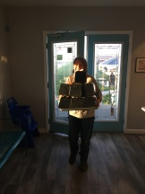 Carrying a pyramid of boxes.