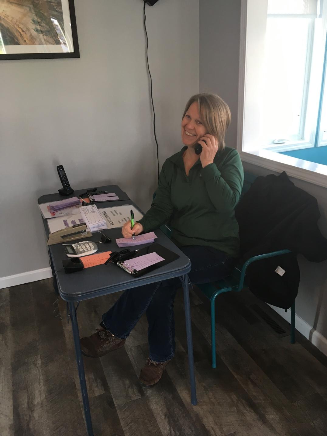 Smiling volunteers staffed the phone, taking orders
