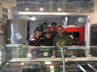 Volunteers working in the pizza kitchen