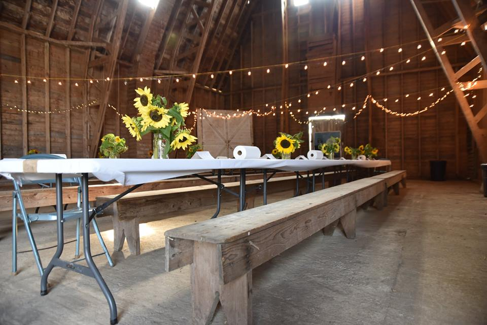 Table decorated for All in the Barn fundraiser